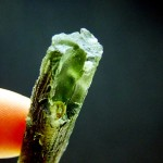 Moldavite with partially open channel