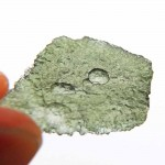 Moldavite with unfinished natural hole