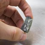 Moldavite before cleaning