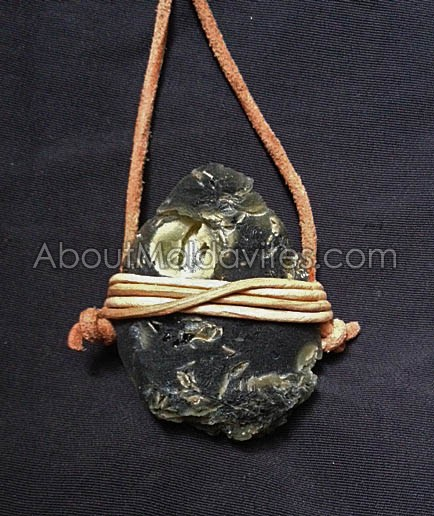 Moldavite wrapped with leather