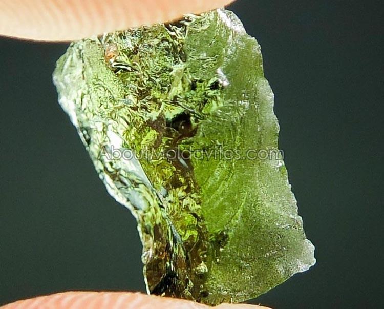 Partially damaged moldavite