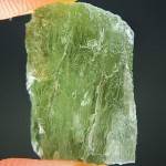 The same partially damaed moldavite