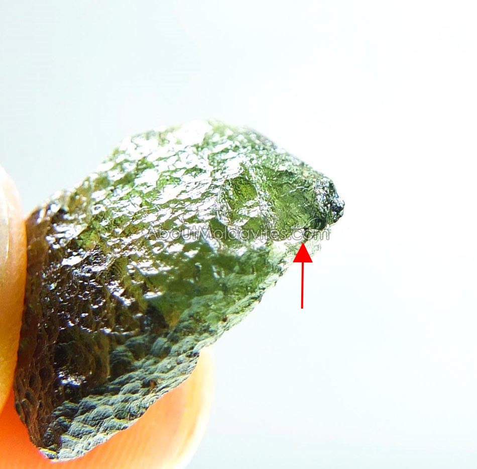 Moldavite with two small damages