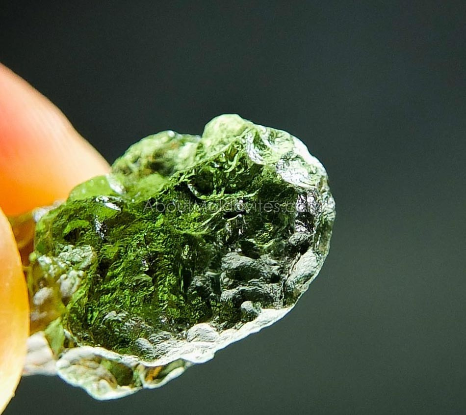 Moldavite with small damaged parts