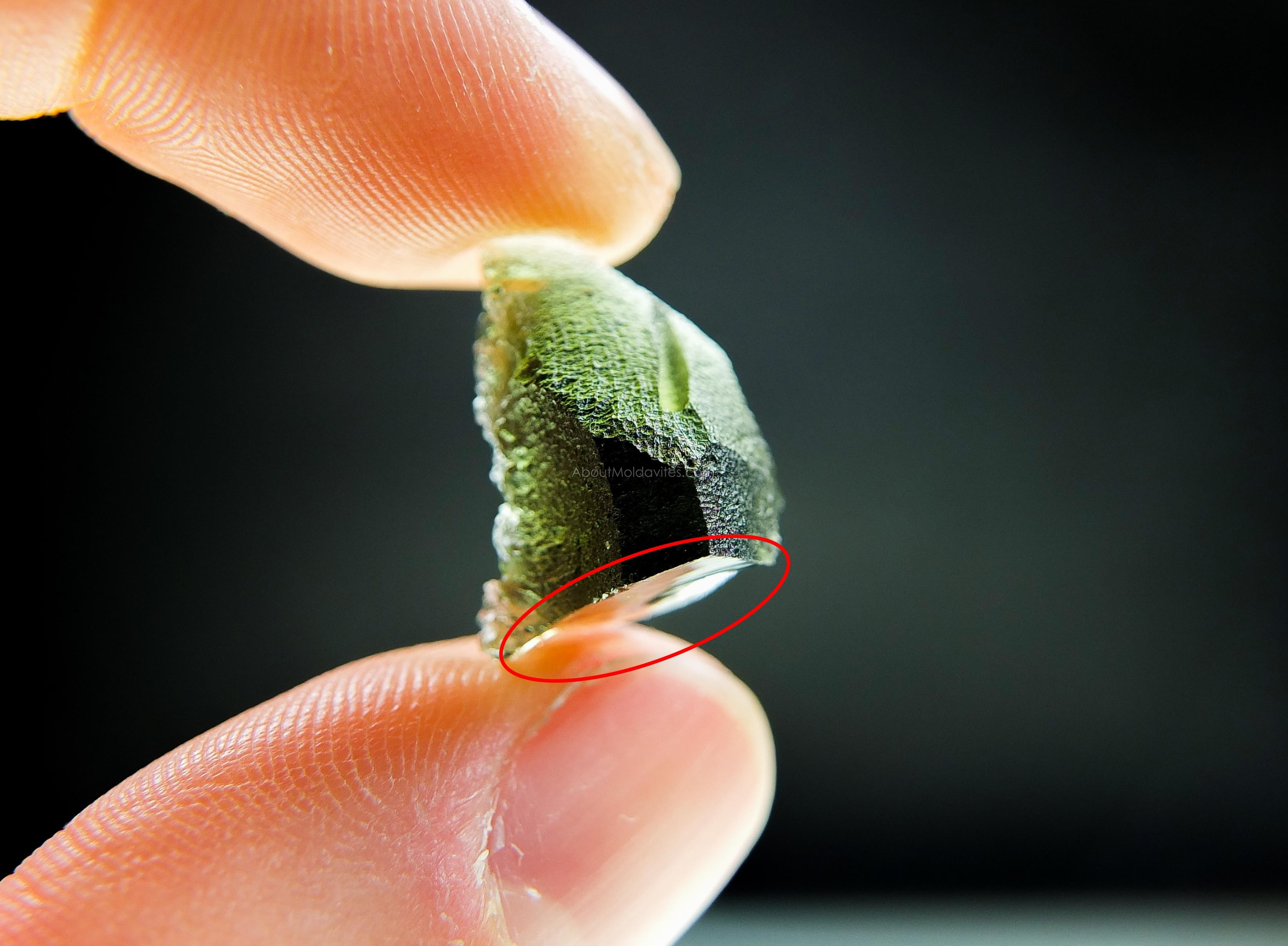 Moldavite with big damage