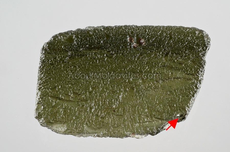 Slightly damaged moldavite