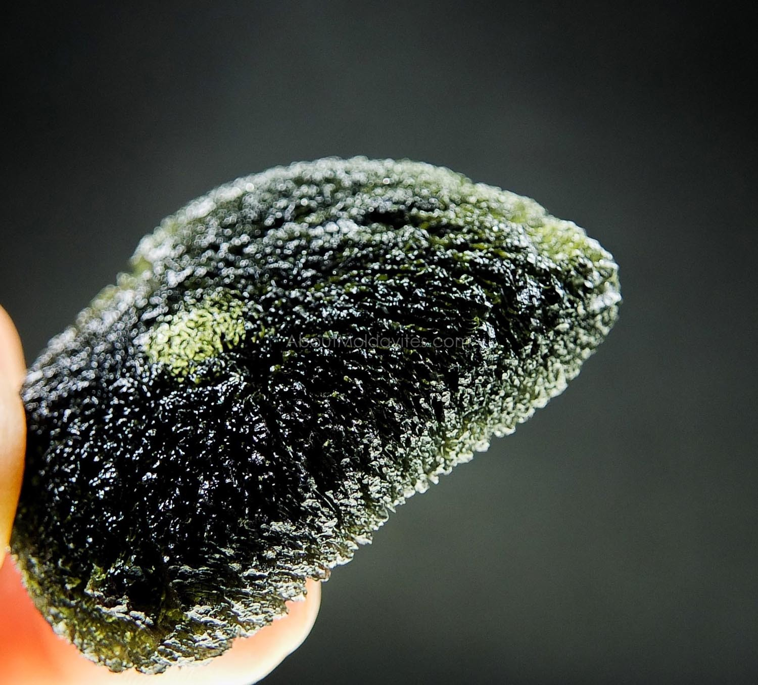 Large moldavite with big closed buuble