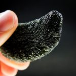 A moldavite with an unusual kind of damage