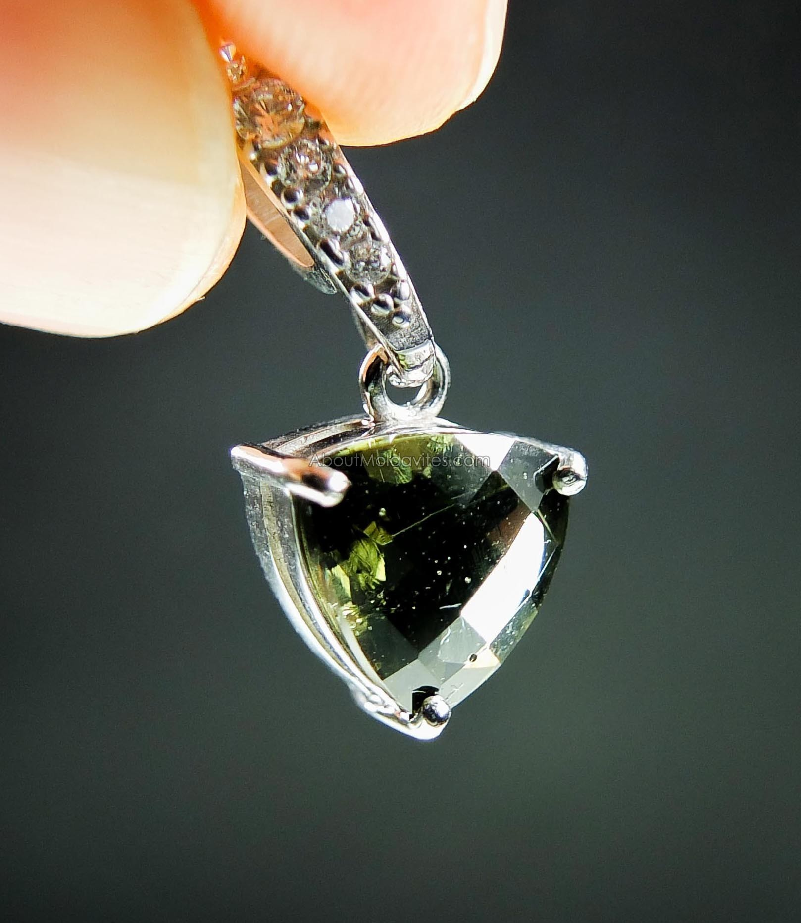 Pendant with faceted moldavite and zirkons