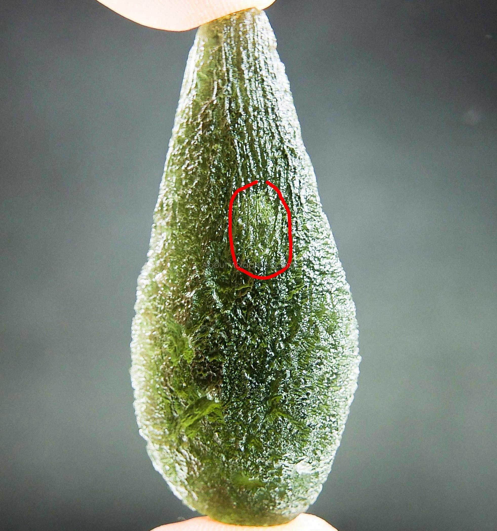 Moldavite with visible big bubble