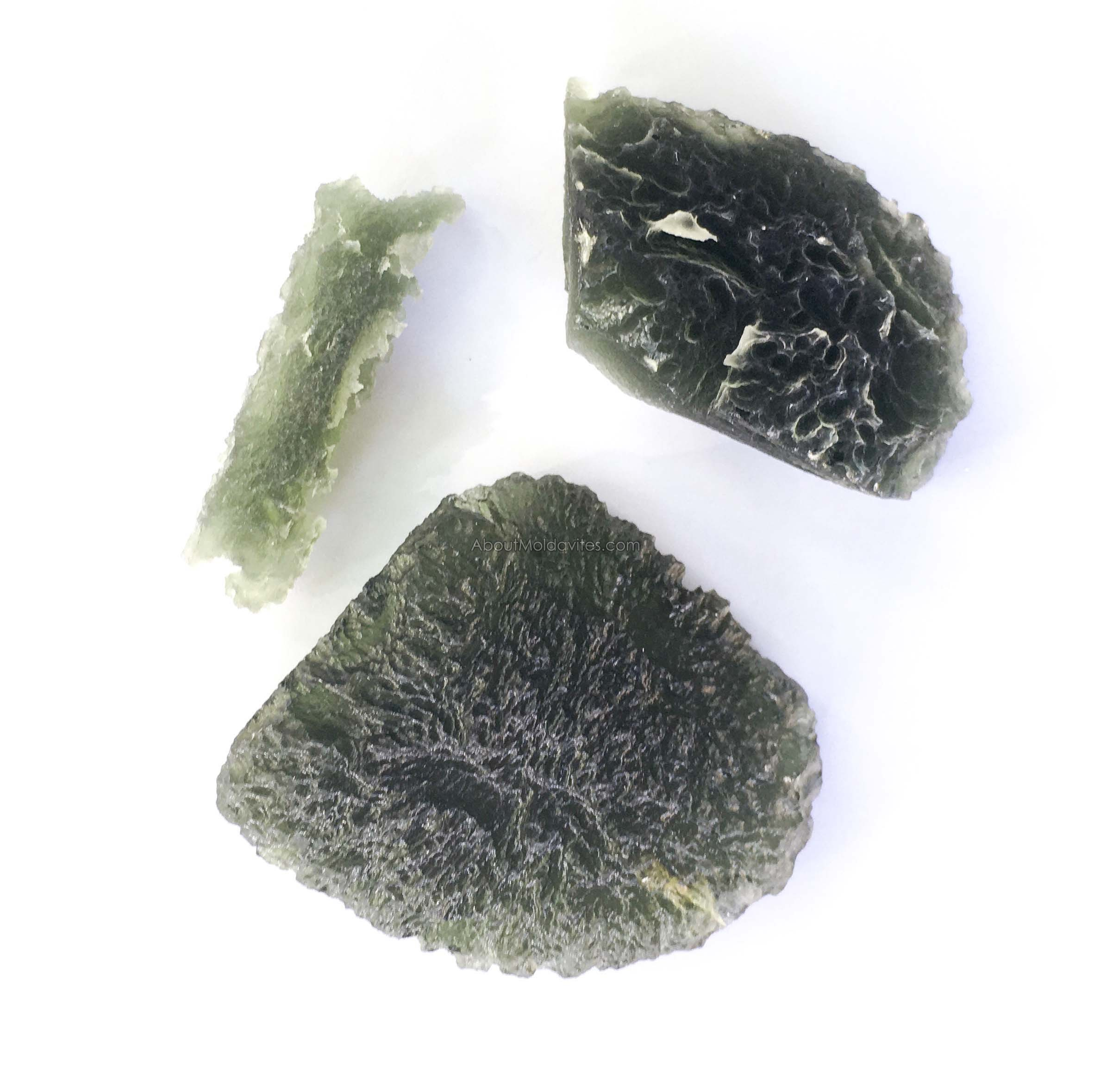 Compare of two Snow flake / frosty moldavites and a normal one